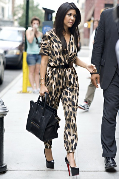 Kourtney Kardashian seen wearing leopard print jumpsuit and Celine handbag in NYC